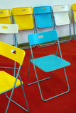 Chairs on Red Carpet. Colorful chairs on red carpet and white wall Stock Image