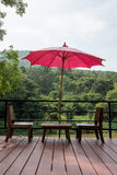 Chairs and red umbrella Royalty Free Stock Photos