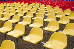Chairs in red and yellow colors. Yellow against red, the winning difference made of chairs Stock Images