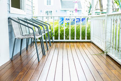 Chairs for relax on wooden front porch Stock Photo