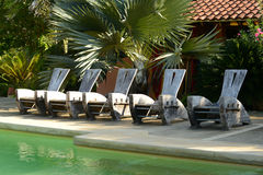 Chairs at resort in tropical location Royalty Free Stock Photo