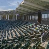 Chairs and rooms at a stadium against blue sky royalty free stock photo