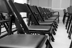 Chairs in a row. Black and white royalty free stock photos