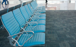 Chairs row in airport. Waiting space. Stock Photo