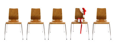 Chairs in a row with gift on white Stock Photos