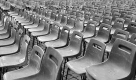 Chairs in a row for outdoor event. Plastic chairs in a row for outdoor event Royalty Free Stock Photos