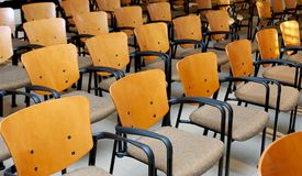 Chairs in rows. In a room stock photo