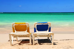 Chairs on sandy beach Stock Photo
