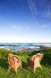 Chairs at the sea Stock Photography