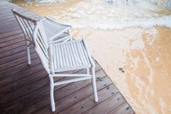 Chairs and sea wave Royalty Free Stock Images