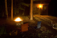 Chairs set around fire pit Royalty Free Stock Photography