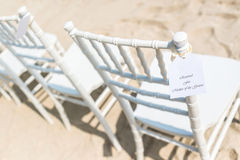 Chairs set up on sand Stock Photos