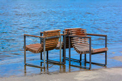 Chairs on shore Royalty Free Stock Photos