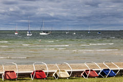 Chairs by the shore of Lake Michigan in Wisconsin Royalty Free Stock Images