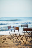 Chairs in sidewalk cafe on beach Royalty Free Stock Photo