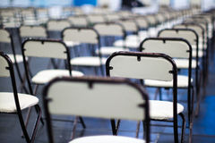 Chairs slender ranks. For a serious event you may need a lot of chairs Stock Photo