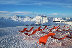 Chairs on the slopes of the mountains in the Alps, Austria. Royalty Free Stock Image