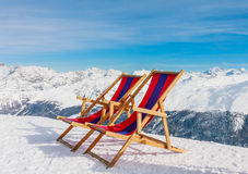 Chairs on the slopes of the mountains in the Alps Royalty Free Stock Photos