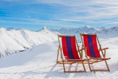 Chairs on the slopes of the mountains in the Alps Royalty Free Stock Images