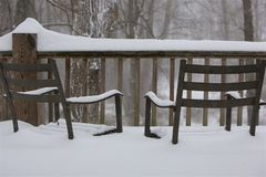 Chairs in snow stock photos