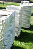 Chairs stacked. Rental chair stacked and brought in for an event Royalty Free Stock Image