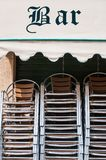 Chairs stacked outside a bar Stock Photo