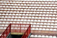 Chairs in the stadium of football without the people Royalty Free Stock Image