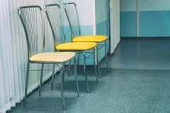 Chairs stand in a row in waiting hall or corridor royalty free stock image