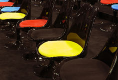 Chairs standing in line at conference room Stock Images