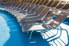 Chairs in sunbathing area on stern of cruise liner Royalty Free Stock Image
