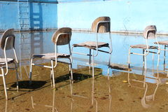 Chairs. Surrealistic chairs in the old abandoned pool Stock Image