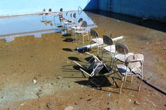 Chairs. Surrealistic chairs in the old abandoned pool Royalty Free Stock Photography
