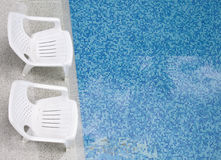 Chairs at the swimming pool Royalty Free Stock Photo