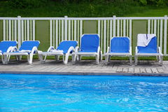 Chairs by Swimming Pool Royalty Free Stock Photos