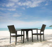 Chairs and table in beach cafe Stock Photos