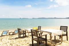 Chairs and table on the beach Stock Photography