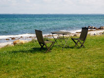 Chairs and table on a beautiful beach Royalty Free Stock Images