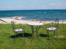 Chairs and table on a beautiful beach Royalty Free Stock Photography