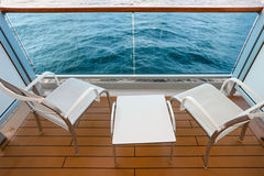 Chairs and table on board of cruise liner Stock Photos
