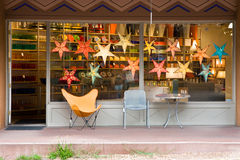 Chairs and table in front a store front Royalty Free Stock Image