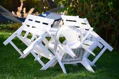 Chairs and table in garden Stock Image