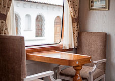 Chairs and table inside a train wagon Royalty Free Stock Image