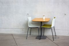 Chairs and table at open-air cafe Royalty Free Stock Photo