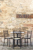 Chairs and table outside Bar in Italy Stock Images