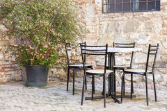 Chairs and table outside a Bar in Italy Royalty Free Stock Images