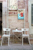 Chairs and table outside of a little coffee shop Royalty Free Stock Photography