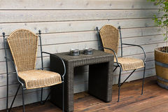 Chairs and table on the patio royalty free stock images