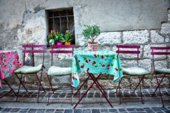 Chairs and table in a street Stock Images