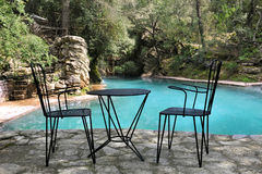 Chairs and table on terrace Stock Photos