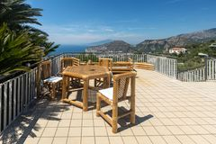 Chairs and table on the terrace overlooking the Bay of Naples and Vesuvius. Sorrento. Italy royalty free stock photos
